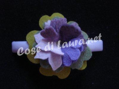 Matic fermacoda con fiore
