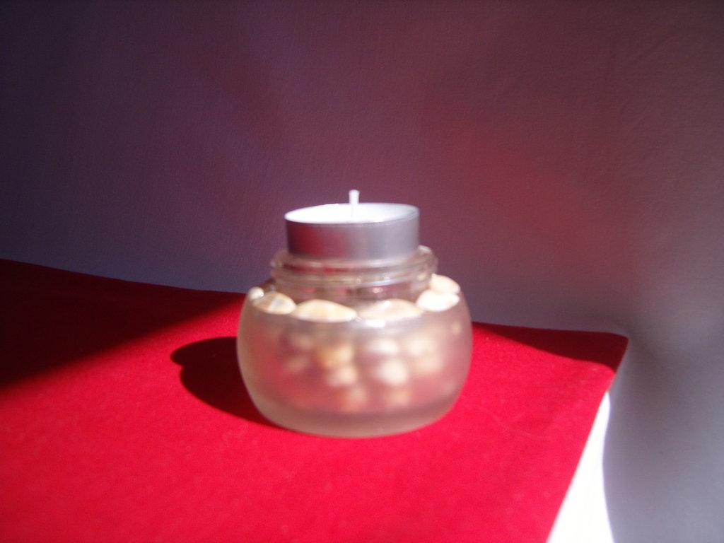 Porta candele di vetro decorate con le conchiglie