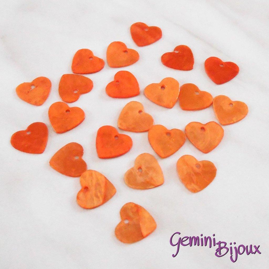 Lotto 10 zecchini pendenti cuore in madreperla 13x12 arancio