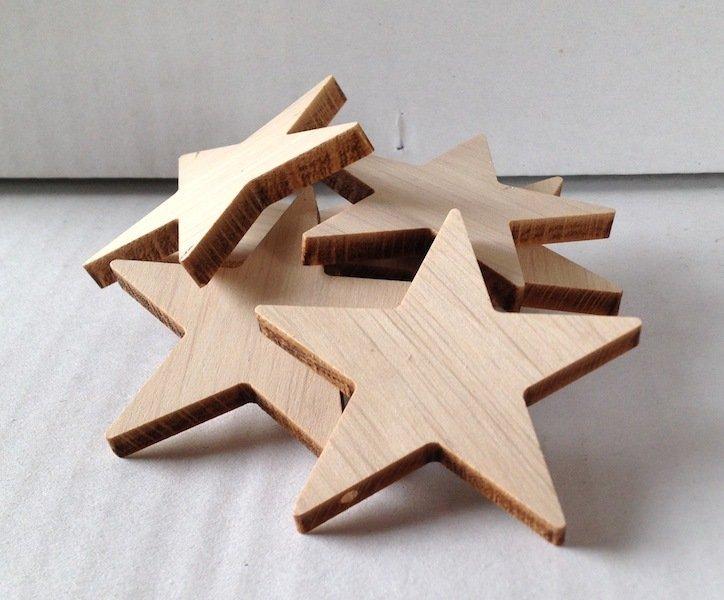 Stelle in legno con foro passante 5,5 cm