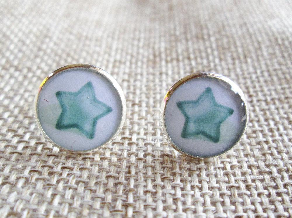 Orecchini in resina con stella azzurra