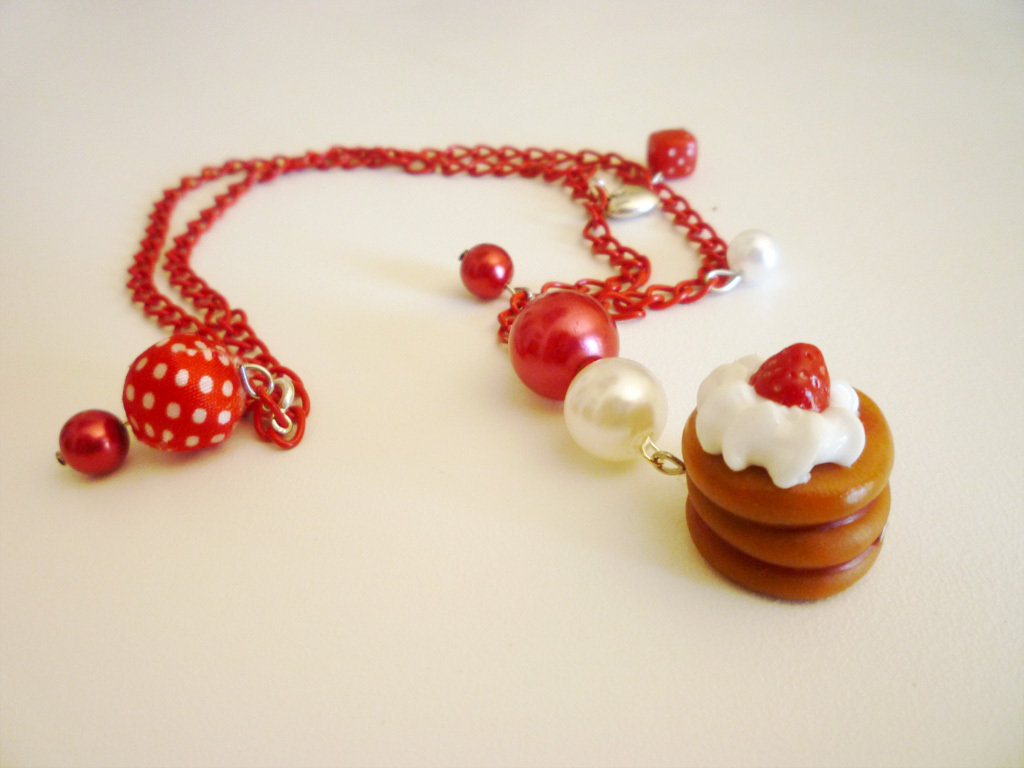 Red pancake with fresh cream and strawberry - necklace