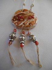 ciondolo etnico in terracotta con perline