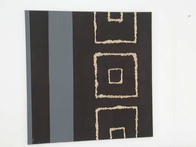 Quadro moderno materico con quadri e righe .