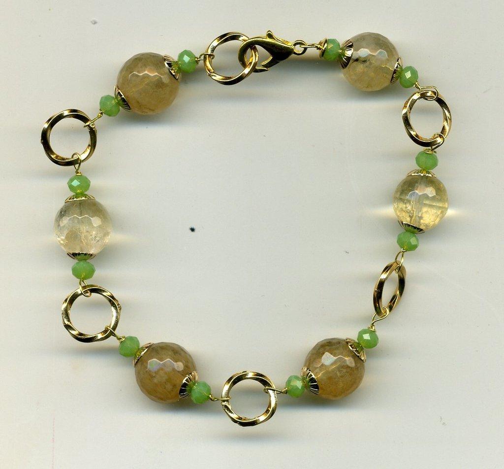 Bracciale in quarzo citrino e anelli dore'