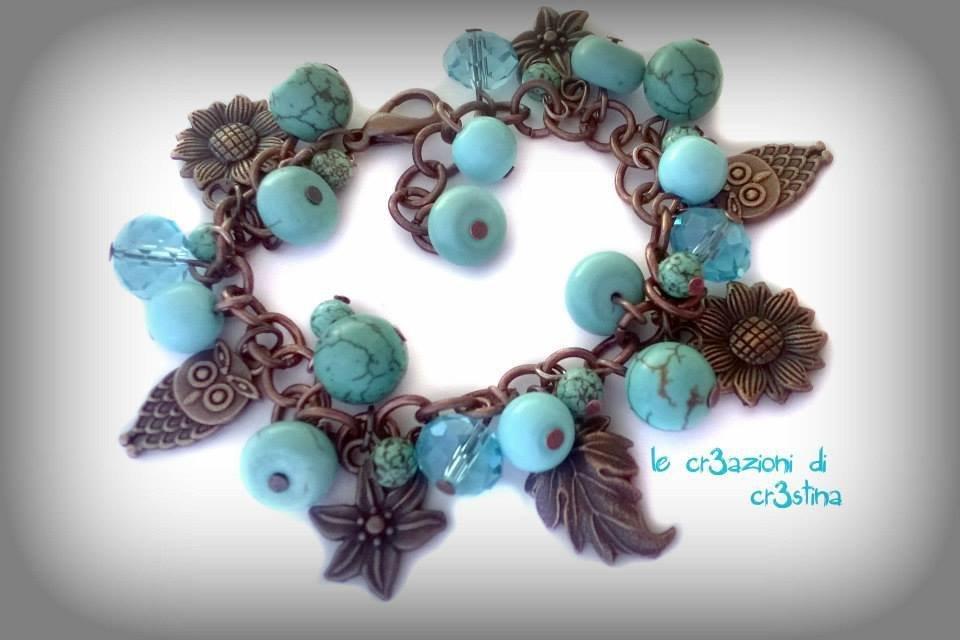 Bracciale con charms bronzo, gufetto, foglie e girasoli, perle e cristalli turchesi