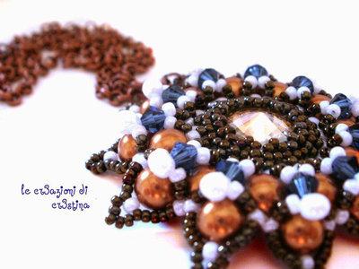 Ciondolo Granada con Rivoli light topaz, bicono montana, perline bronzo e bianche
