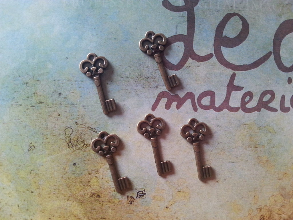 Charm chiave in bronzo 22x10mm