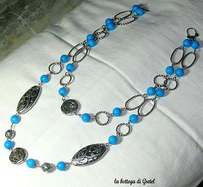 collana azzurra e argento