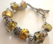 Bracciale con base in metallo,perle gialle a foro largo ed elementi in argento tibetano idea regalo