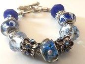 Bracciale con base in metallo,perle a foro largo nei toni del blu e distanziatori in argento tibetano idea regalo