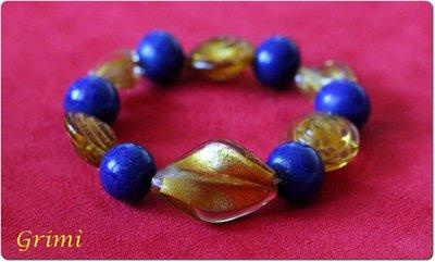 Bracciale elastico con vetro dorato e vetro di Murano blu con avventurina
