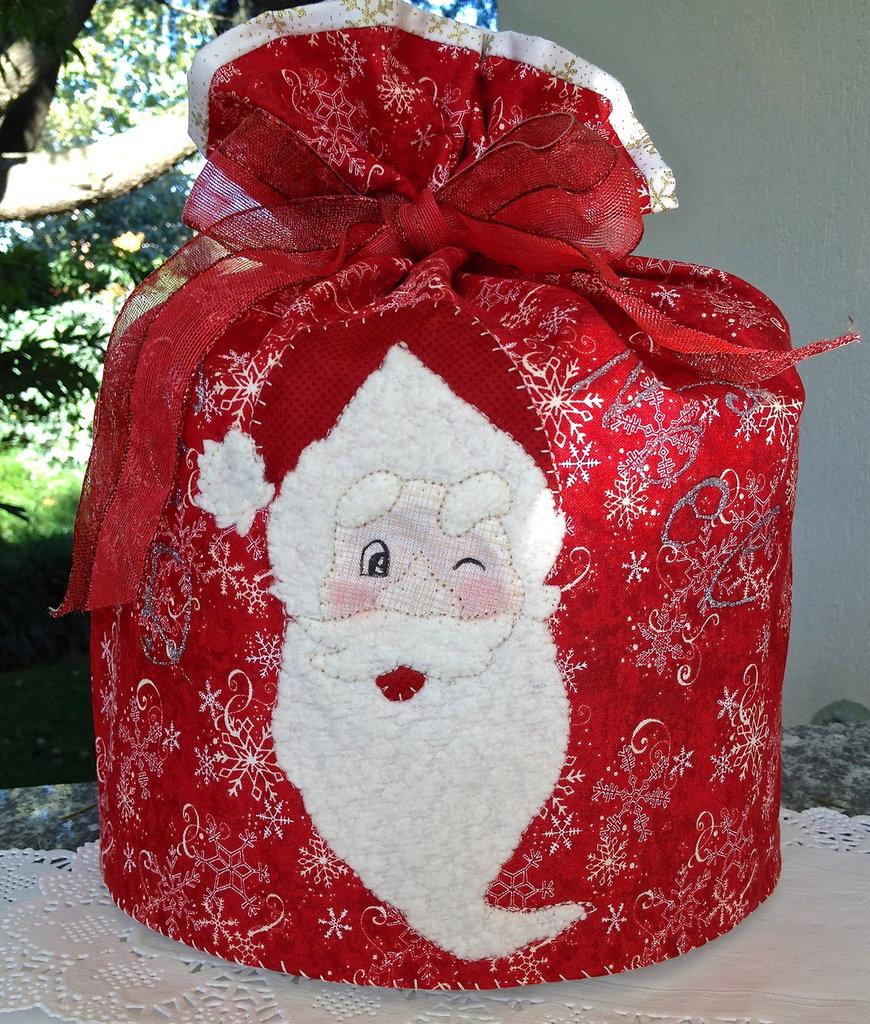 Natale - porta panettone con Babbo Natale che fa l'occhiolino