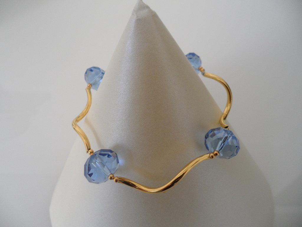 Bracciale Luminoso Dorato con Cristalli Azzurri