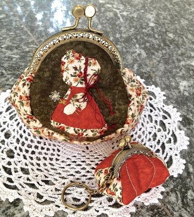 Borsellino in stoffa clic clac con bambolina Sue