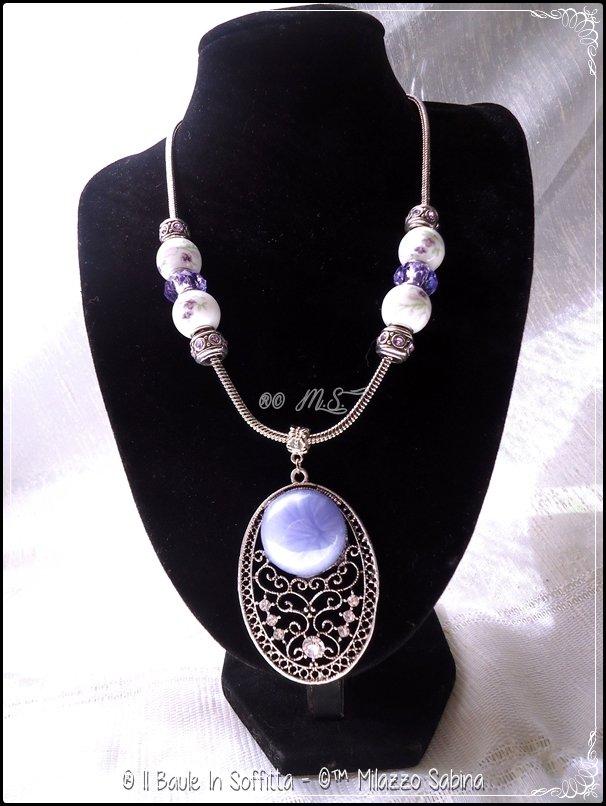 Collana in acciaio con medaglione in filigrana d'argento indiano e trollbeads porcellana
