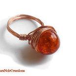 anello in rame e perla arancione in vetro