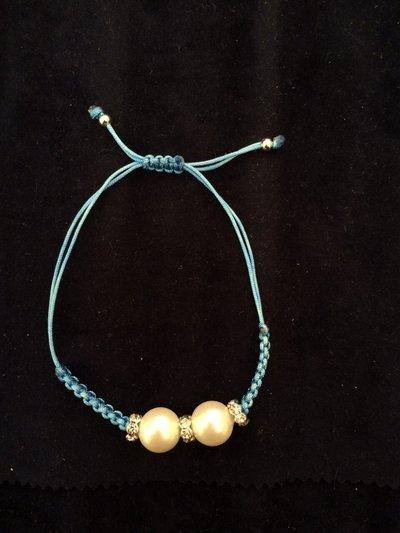Bracciale perle e zirconi celeste/azzurro
