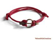 Bracciale con freccia in bronzo cordino rosso