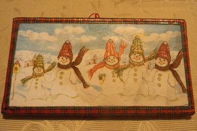 Quadretto natalizio con pupazzi di neve.
