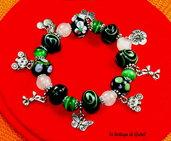 bracciale rosa e verde con occhi di gatto e lampwork