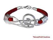 bracciale chiave di violino creato a mano in metallo martellato cinturino rosso