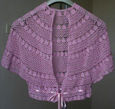 Coordinato mantella e pochette colore rosa fatto al uncinetto filato effetto seta