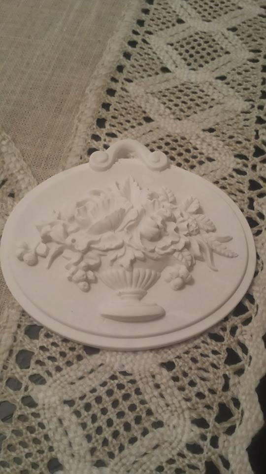 Blasone floreale in polvere ceramica