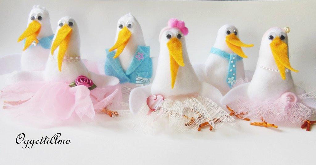 Cicogne rosa e celesti da applicare a fiocchi nascita