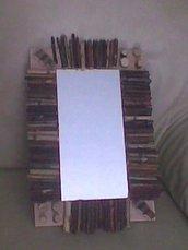 Specchio decorativo con legnetti
