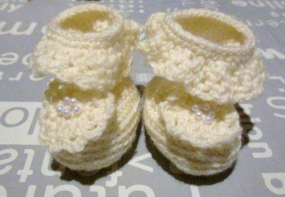 Scarpette neonata di lana color panna
