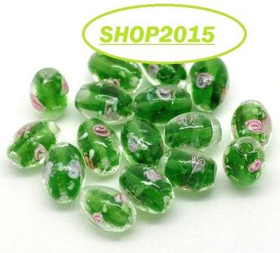 Perla ovale in vetro verde con fiore rosa 14×10mm