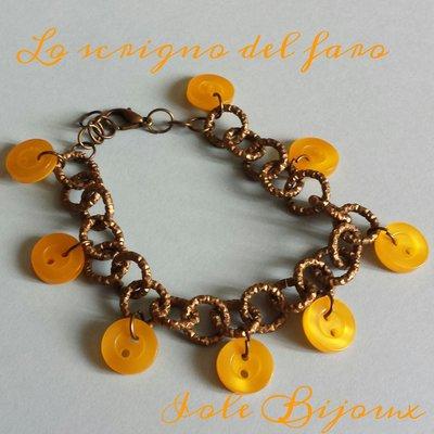 Bracciale color bronzo con bottoni gialli
