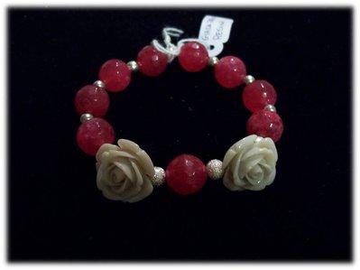 bracciale elastico con pietre fucsia e rose