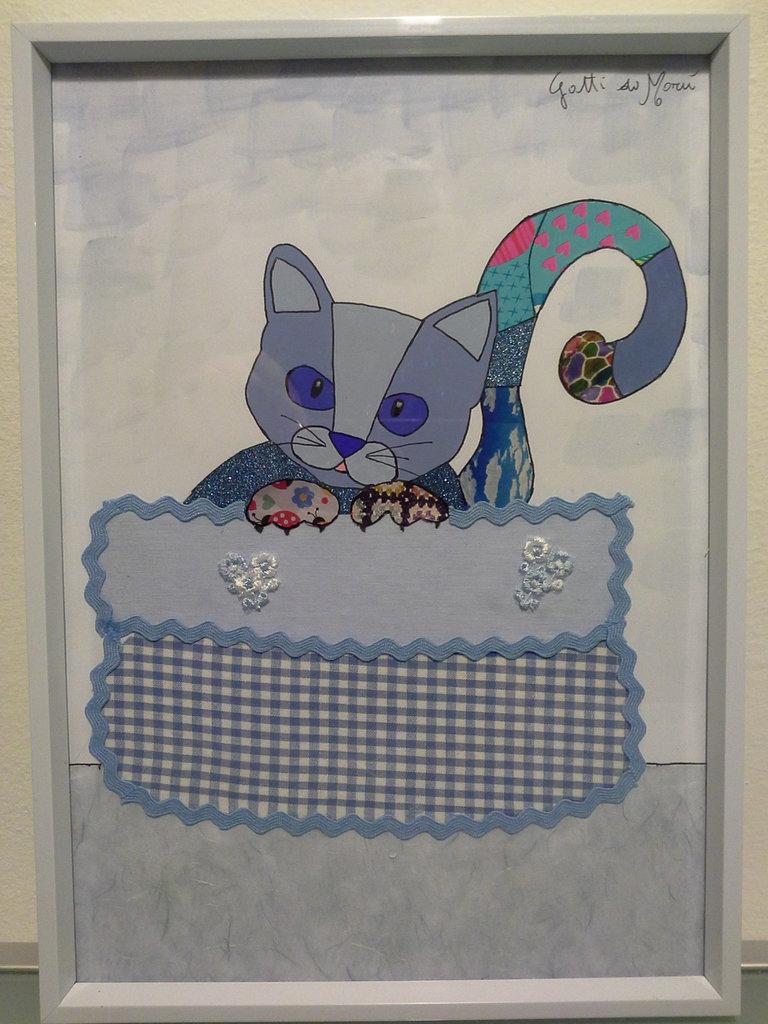 Quadro con gattino nel cestino