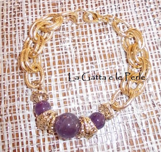 Bracciale color oro con pietre Ametista