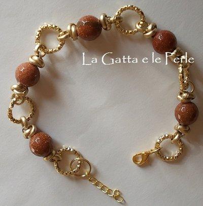 Bracciale color oro con Pietra del Sole (Perle Sintetiche)