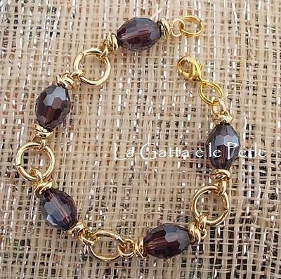 Bracciale con perle di forma ovale e sfaccettate in Mezzo Cristallo Viola