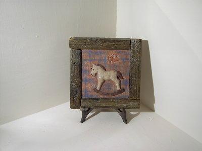 Quadretto con cavallo a dondolo