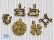 6 charms misti bronzo