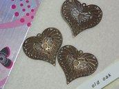 pendente a forma di cuore effetto filigrana in bronzo antico
