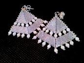 Punta di freccia e perle