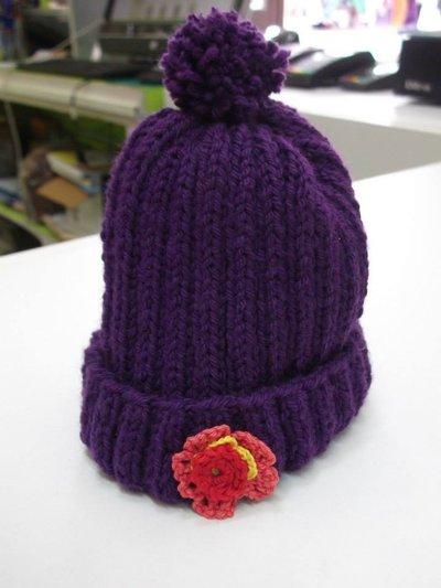 cappello bimba lana viola con pon pon e fiore