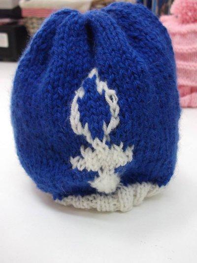 cappello bimbo blu con ciuccio bianco