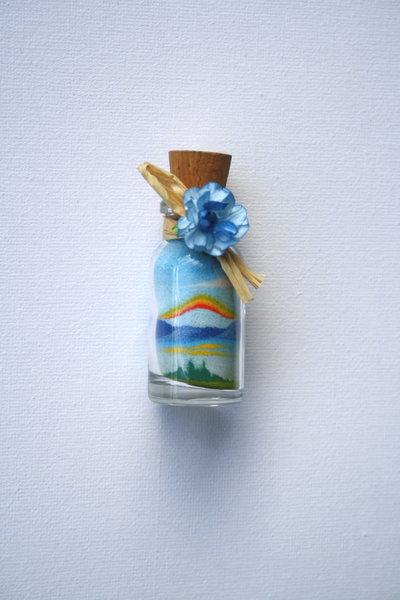 Bottiglie con paesaggi  - bomboniere - in sabbia Mod. Bott. mignon Arcobaleno