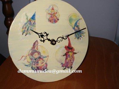 Orologio con fate