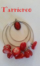 CIONDOLO ORFEO - struttura acciaio/pietre rosse/filo metallo morbido