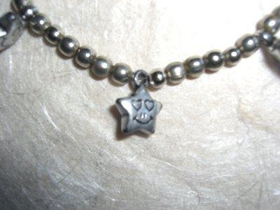Bracciale con perline di metallo e in argentone
