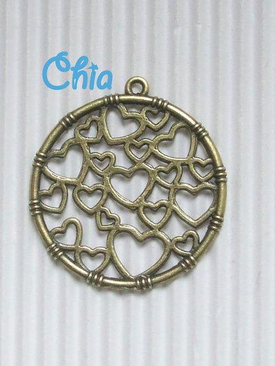 1 charm cuori traforati bronzo 35x32mm