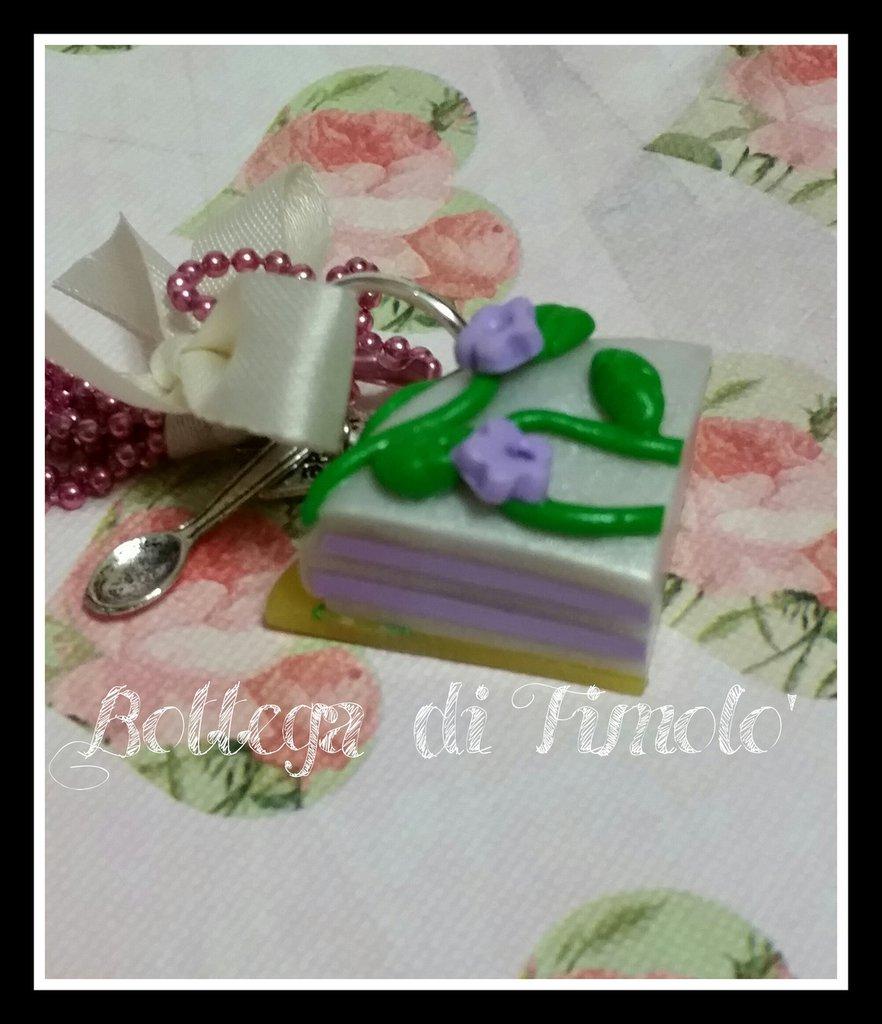 collana microsfere con fettina di torta e charms